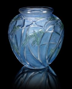 René Lalique 'Sauterelles' a Vase, design 1913 frosted glass, heightened with blue and green staining 26.4cm high