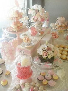 Tiered dessert stands; trays and assorted china plates, cups and saucers would make a pretty way to display your sweets.