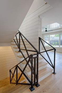 This farmhouse stair is made of black steel, crossed barn look guardrails and steel cable wire. Walls are shiplap. Farmhouse stair made of black steel, crossed barn look guardrails with steel cable wi Modern Farmhouse Design, Modern Farmhouse Bathroom, Modern Farmhouse Exterior, Farmhouse Interior, Farmhouse Renovation, Farmhouse Ideas, Metal Stair Railing, Staircase Railings, Staircase Design