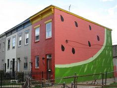 "The inspiration was accidental. ""when the painters did the front of the house fire-engine red and the side came out like Pepto-Bismol,"" Healy said. ""So they grabbed black and pink and green and painted a watermelon."""
