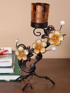 Metal Designer Copper Candle Stand - The colorful metallic petals on this stand look absolutely amazing and will surely make it look like a showpiece as well.