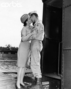 Robert Byrum kisses his sweetheart Thelma Conine goodbye as his train leaves Camp Patrick Henry after World War II on August