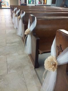 pew decoration / tulle and paper flowers ~ #wedding #aisle #pew decor ideas - spotted by www.huntshamcourt.co.uk