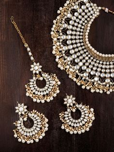Beautiful Zaveri Pearls Women Gold Toned & White Kundan & Pearl Embellished Jewellery Set – You will find different rumors … Indian Bridal Jewelry Sets, Indian Jewelry Earrings, Jewelry Design Earrings, Wedding Jewelry Sets, Bridal Jewellery, Wedding Accessories, Pakistani Bridal Jewelry, Kundan Jewellery Set, Jewlery