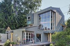Seattle waterfront home features wall of glass, houseboat views