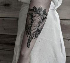 Unterarm Tattoo für Frau elephanten-mandala-hintergrund