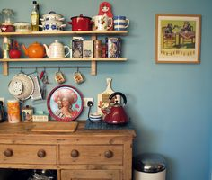 Mid-century kitchenware lust; the blue wall makes it perfect