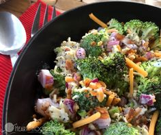Tangy and slightly sweet and oh, so delicious. You'll definitely be bringing this Broccoli Salad again and again.