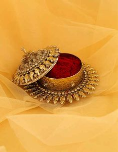 Select beautiful range of sindoor box online from the huge collection. We offer silver kumkum box, gold plated kum kum bharani and fancy sindoor dani at best price. Indian Wedding Gifts, Indian Wedding Jewelry, Indian Jewelry, Bridal Jewelry, Jewelry Box, Jewelery, Jewelry Accessories, Jewelry Design, Silver Pooja Items