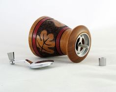 Decorative Mahogany Mini Salt or Pepper Mill USA by Woodistry, $49.00.  These mills are a real team effort between my wife and myself. I turn the mills on the lathe and then she does the pyrographic art work and adds color.