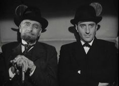 """Basil Rathbone and George Zucco in The Adventures of Sherlock Holmes 1939.  """"I admire your brain Moriarty. So much that I would like to present it pickled in alcohol to the London Medical Society"""""""