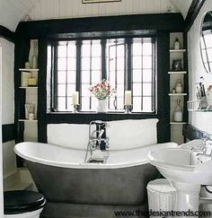 The black windows really make this bathroom - note narrow shelving around window