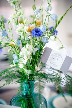 blue and green, photo by Kaitie Bryant Photography http://ruffledblog.com/notwedding-athens #flowers #weddingideas #centerpieces