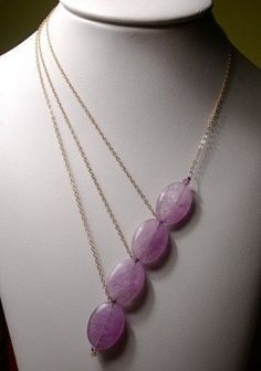 Interesting and simple! three chain, four bead contemporary statement necklace with lilac ovals.