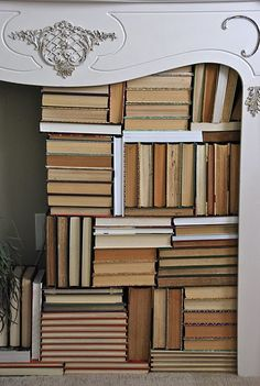 fireplace filled with books... i think i would have a constant fear of paper + fire