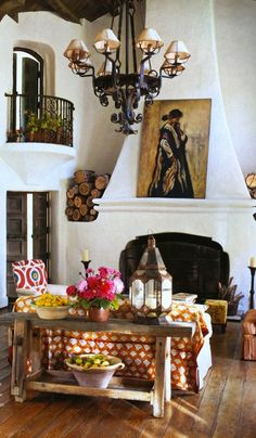 #PlasterFireplace, Casa Mexicana, #Spanish Colonial style Home with white plaster fireplace, wrought iron balcony, wrought iron chandelier and rustic furniture. Interior Architecture.  Live Beautifully!