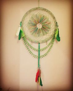 Home made green Dreamcatcher with macaw feathers #dreamcatching