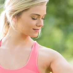 25748163 - active smiling blonde lifting dumbbells in a park on a sunny day