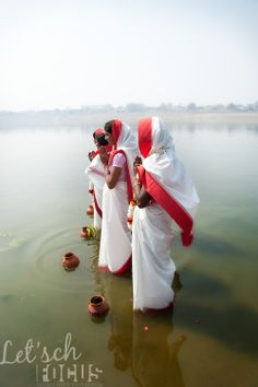 Hindu women bow in prayer and perform religious rituals in gratitude to river Ganga held sacred by followers of Hinduism. Millions of Hindus...
