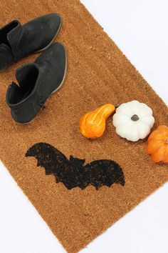 Turn a plain old doormat into a cute Halloween decoration with our tutorial for a DIY Halloween Doormat. Check out the video tutorial!