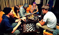 Some Red Hot playing simultaneous chess games with SGM Magnus Carlsen, 2011.