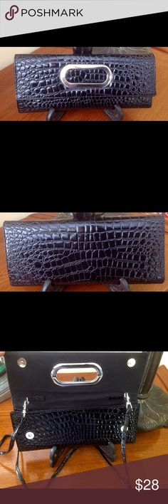 Patent black faux leather clutch This beautiful and elegant black clutch has hidden shoulder strap and can be used day and night. BohoMoho Bags Clutches & Wristlets