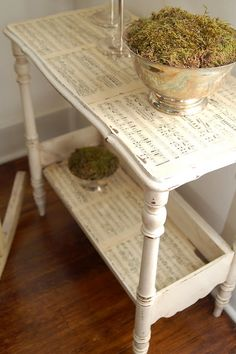 Table decorated with old sheet music.