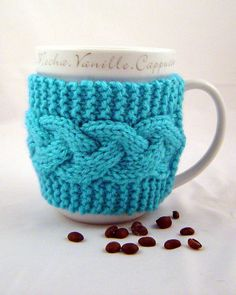 The cool weather makes me want to pick up my knitting needles and make cabled mug cozies.