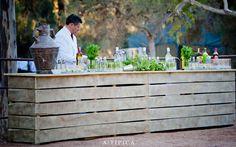 Wedding in Cartagena, Spain Designed and produced by ATIPICA. Rustic bar withe green flowers  Boda en Cartagena, España diseñada y producida por A-TIPICA. Barra rustica con flores en verdes.