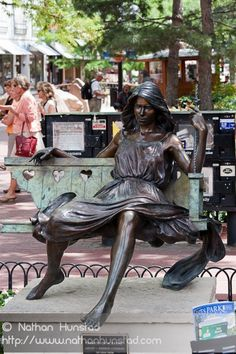 """A sculpture on the Pearl Street Mall in Boulder, CO, entitled """"Hearts on a Swing"""", by George Lundeen"""