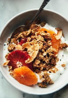 Crispy and delicious vegan tahini granola with orange zest. Coconut and cacao nibs are added for crunch and dried mulberries bring a sweet-tart edge.