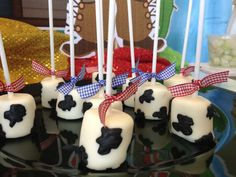 Cow marshmallow pops at a cowboy birthday party! See more party planning ideas at CatchMyParty.com!