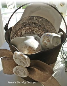 rusty bucket roses burlap and transferware what could be better
