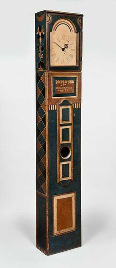 """TALL CASE CLOCK/ Johannes Spitler (1774-1837), 1801, paint on yellow pine, with brass and steel works, modern watercolor and ink on period-paper face, and original sheet-iron dial, 85 1/2 x 14 3/4 x 8 1/4"""", collection American Folk Art Museum, New York, gift of Ralph Esmerian, 2005.8.27. Photo by Gavin Ashworth"""