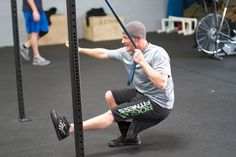 A great way to scale the one-legged squat aka Pistol is to use a band.  This way the athlete still commits to shifting his/her weight similar to an air squat