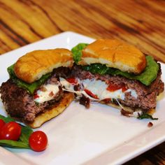 Caprese Stuffed Burger.  Yummmm.  All of my favorite flavors oozing out of this juicy burger!