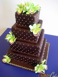 Chocolate and Green Orchids Wedding Cake  I know vanilla cake with white would go with my dress and probably the color scheme of my wedding.. But Chocolate cake is my favorite.. And I want cake that tastes good.