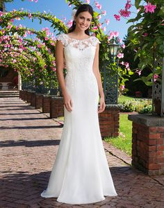 Available at Adore Bridal Boutique! www.adorebridalga.com Sincerity wedding dress style 3916 Beaded embroidered and corded laces adorn this lightweight, classic chiffon gown with a Sabrina neckline, fit and flare silhouette with a chapel length train.