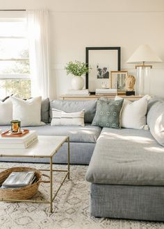Coffee Table Styles - Harlowe James Neutral colored living room with grey sectional. Grey Sectional, Living Room Sectional, Living Room Decor, Living Spaces, Interior Styling, Interior Design, Mug Design, Acrylic Table, Coffee Table Styling