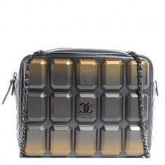 Chanel (new) Metallic Lambskin Plexiglass Evening Art Flap Shoulder Bag. Get one of the hottest styles of the season! The Chanel (new) Metallic Lambskin Plexiglass Evening Art Flap Shoulder Bag is a top 10 member favorite on Tradesy. Save on yours before they're sold out!