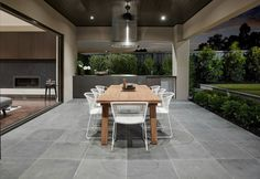 outdoor room with grey floor tiles and built in bbq area on the life creative