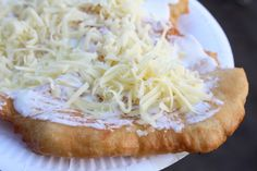 """What it is: A plate-sized sheet of fried dough that is usually smothered with sour cream and cheese. Other possible toppings include garlic sauce or ketchup.Why it's awesome: Did you miss the part where I wrote """"fried dough""""?Get a recipe [here]. Hungarian Cuisine, Hungarian Recipes, Hungarian Food, Hungarian Desserts, Croatian Recipes, German Recipes, European Dishes, European Cuisine, International Recipes"""