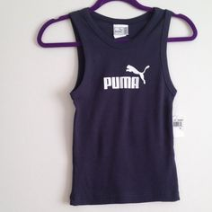 Puma navy top NWT ...It's medium size on the tag but fits XS/S size .Got it from another posher but it's too small on me . Puma Tops