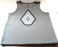$16.98/ Men's grey/gray sleeveless Volcom Tank Top/muscle shirt with Logo graphic,Size Large   ~~view over 500 items in over 20 categories of merchandise in my ebay store. I ship globally... SHIPPING iis ALWAYS FREE in the states. www.shellyssweetfinds.com