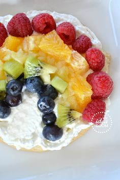 Rainbow Fruit Pizza with Sugar Cookie and Frosting Recipe via Amy Huntley (The Idea Room)