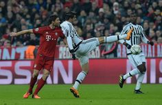 Bayern Munich's Spanish midfielder Xabi Alonso vie for the ball with Juventus' forward from Spain Alvaro Morata during the UEFA Champions League, Round of 16, second leg football match FC Bayern Munich v Juventus in Munich, southern Germany on March 16, 2016.