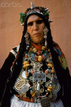 Africa | A Berber woman dressed for the celebration of Moussem. Tarhjijt, Morrocco. | © Olivier Martel/Corbis