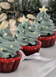 Christmas Tree Cupcakes - piped green into a swirled tree with a bit of decor - how festive is this?!!