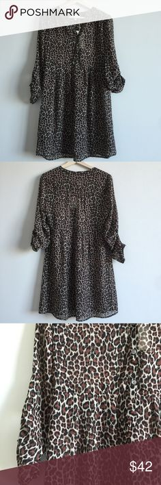 "Two By Vince Camuto Leopard Print Shirtdress 🌷Please Read the description! Thanks!🌷  Brand new with tag Retail: $129 Size: S 100% polyester  Button tabs roll the long sleeves for a second wearing option. Measurements: arm pit to arm pit "", length  Color may be slightly different bcz of lighting  🌷Price is FIRM unless bundled 🌷NO Trades         🌷NO Holds 🌷All sales are final Two by Vince Camuto Dresses"