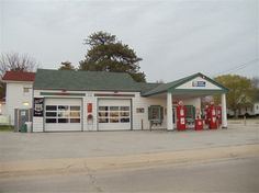 """Ambler's Texaco station along the original Route 66 in Dwight, a gas station with the oft-referred """"house and canopy"""" design."""